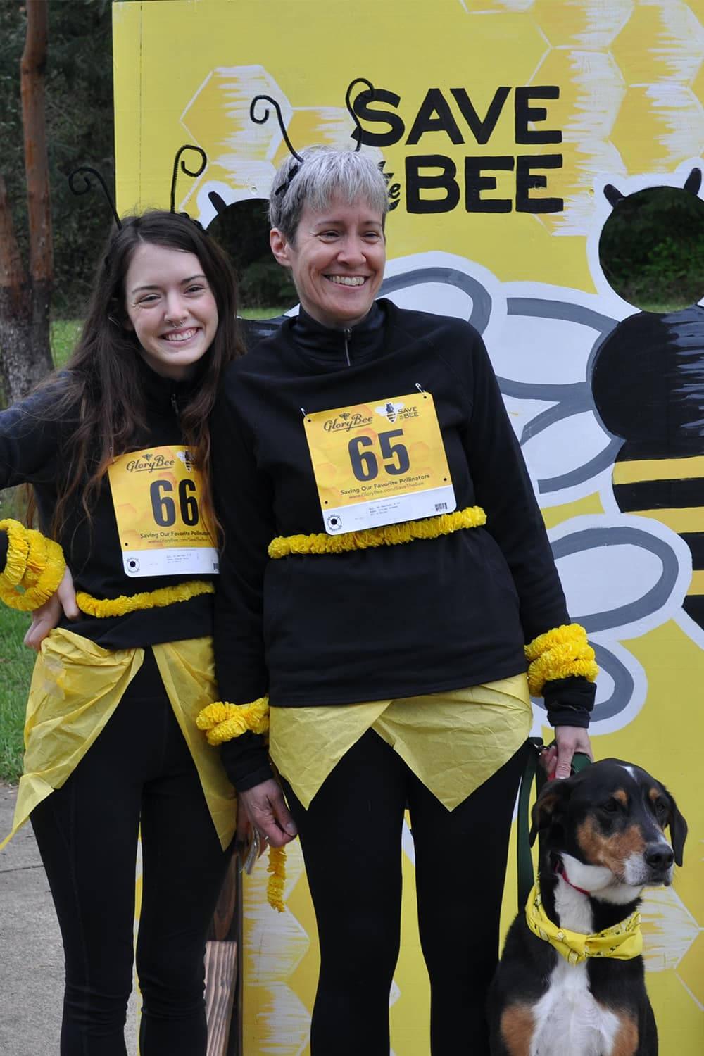 Two women running the race the bee race